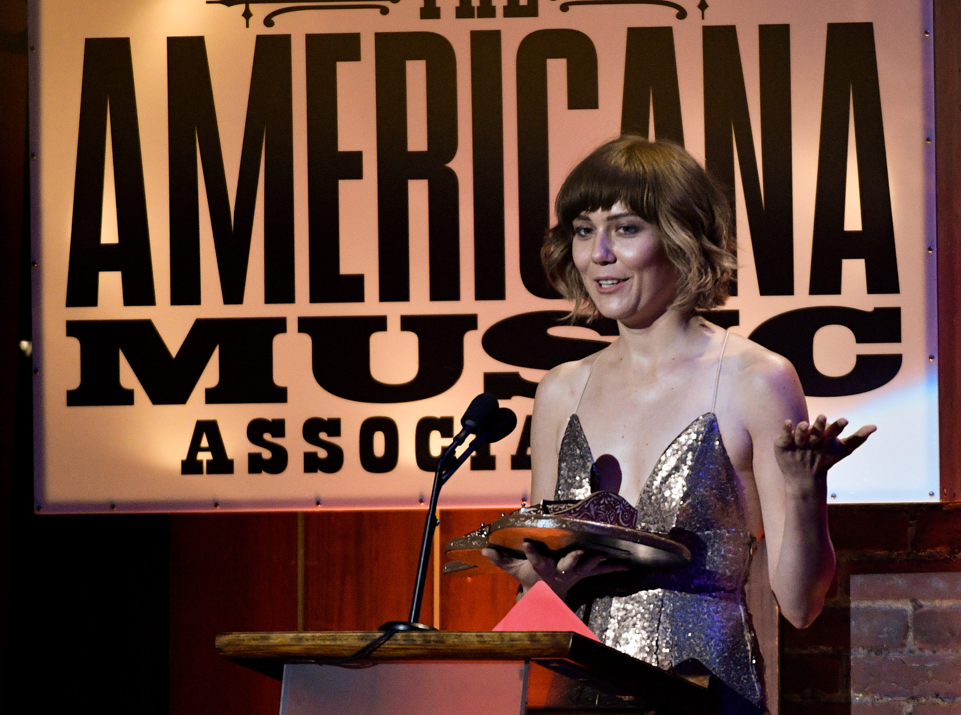 Instrumentalist of the Year Molly Tuttle accepts her award during the 2018 Americana Honors and Awards show at the Ryman Auditorium in Nashville, Tenn., Wednesday, Sept. 12, 2018.
