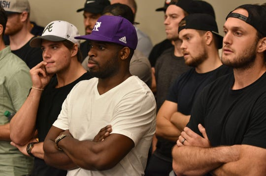Defenseman P.K. Subban (center) and the rest of the Predators watch the press conference Thursday.