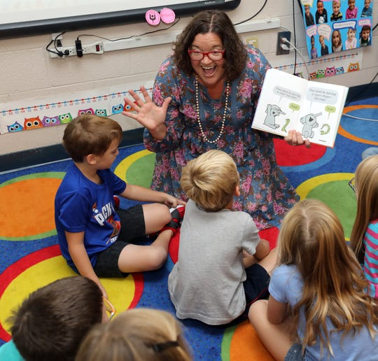Teacher Melissa Miller reads to her class at Franklin Elementary School Wednesday September 12, 2018.