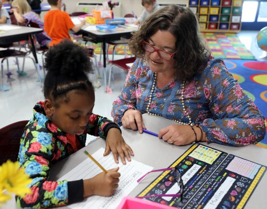 Teacher Melissa Miller works with Jakaree Miller on a writing assignment at Franklin Elementary School Wednesday September 12, 2018.