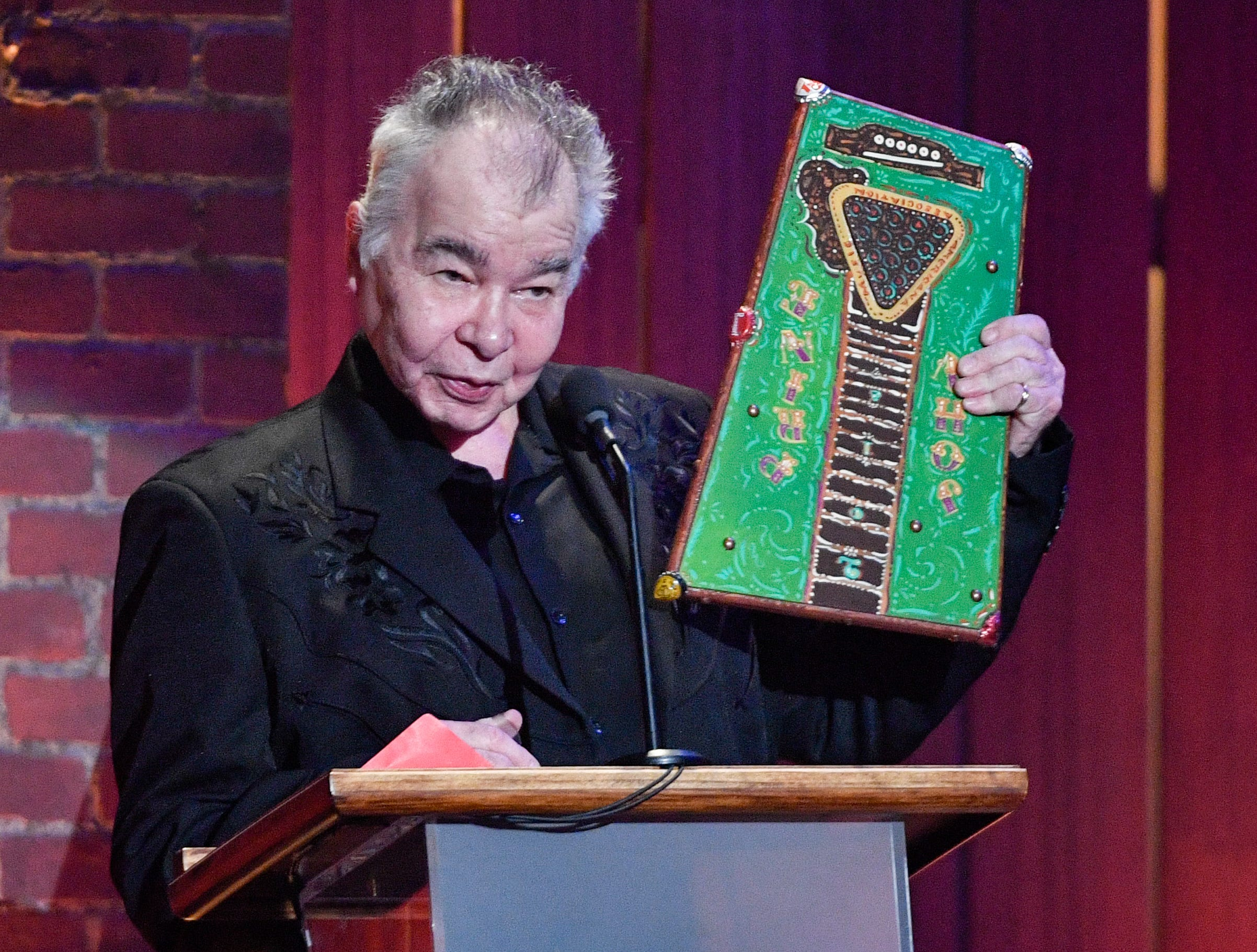 John Prine accepts the Artist of the Year award during the 2018 Americana Honors and Awards show at the Ryman Auditorium in Nashville, Tenn., Wednesday, Sept. 12, 2018.