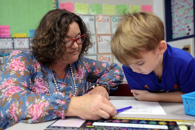 Teacher Melissa Miller works with Mac Mullins on a writing assignment at Franklin Elementary School Wednesday September 12, 2018.