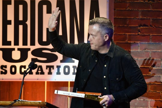 Jason Isbell accepts the song of the year award at the 2018 Americana Honors and Awards show in Nashville, Tenn. It was one of three trophies Isbell hauled home from the Ryman Auditorium at the end of the night.