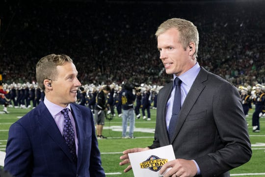 Analyst Chris Simms, right, before a football game.