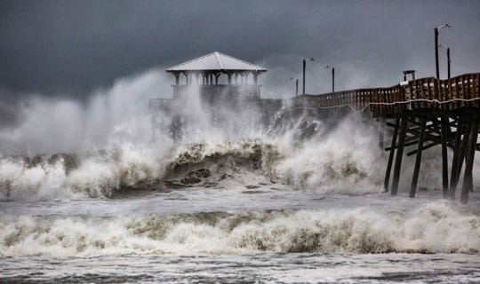Waves slam the Oceana Pier & Pier House Restaurant in Atlantic Beach, N.C.,  on Thursday, Sept. 13, 2018, as Hurricane Florence approaches the area.
