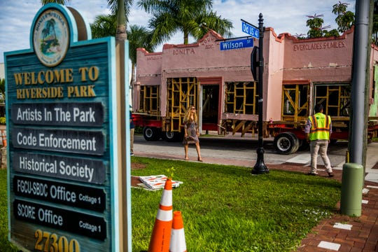 Passers-by watch as the historic Dixie Moon building is relocated in downtown Bonita Springs on Thursday, Sept. 13, 2018. The more than 90-year-old building was originally at the corner of Old 41 Road and Dean Street and was moved to near Riverside Park.