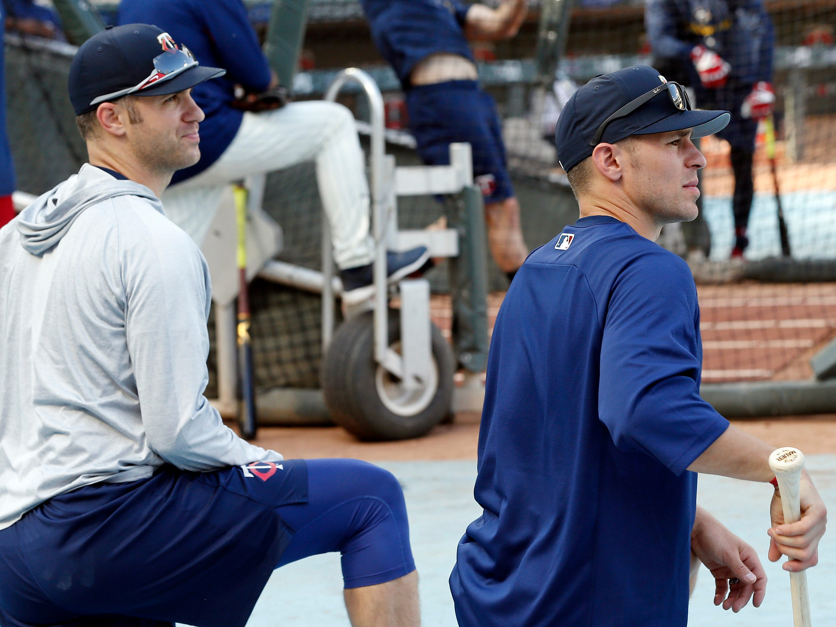Minnesota Twins' Joe Mauer, left, and Minnesota Wild's Zach Parise, a former star with the New Jersey Devils, watch batting practice before a baseball game between the Twins and the New York Yankees Wednesday, Sept. 12, 2018, in Minneapolis. Several of the NHL hockey team players took part in batting. The Wild open training camp Thursday in St Paul, Minn.
