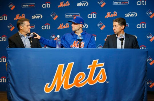Sep 13, 2018; New York City, NY, USA;   (left to right) New York Mets assistant general manager John Ricco and third baseman David Wright (5)  with chief operating officer Jeff Wilpon during press conference before game against the Miami Marlins at Citi Field.