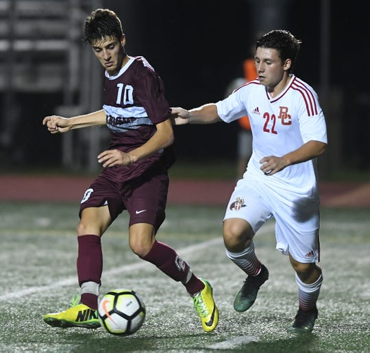 Bergen Catholic at Don Bosco on Wednesday, September 12, 2018. BC #22 Jason Knoller and DB #10 Jason Bouregy in the first half.