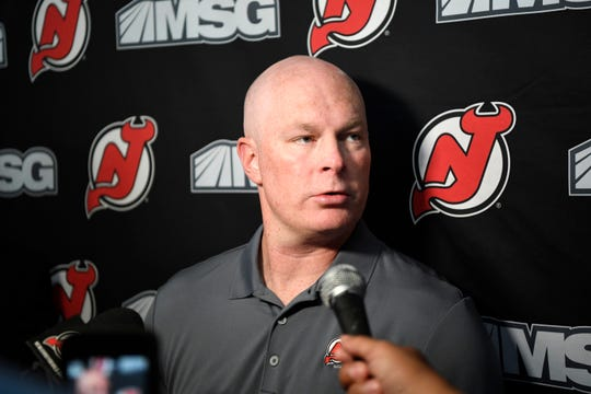New Jersey Devils head coach John Hynes talks to reporters during media day at the Prudential Center in Newark, NJ on Thursday, September 13, 2018.