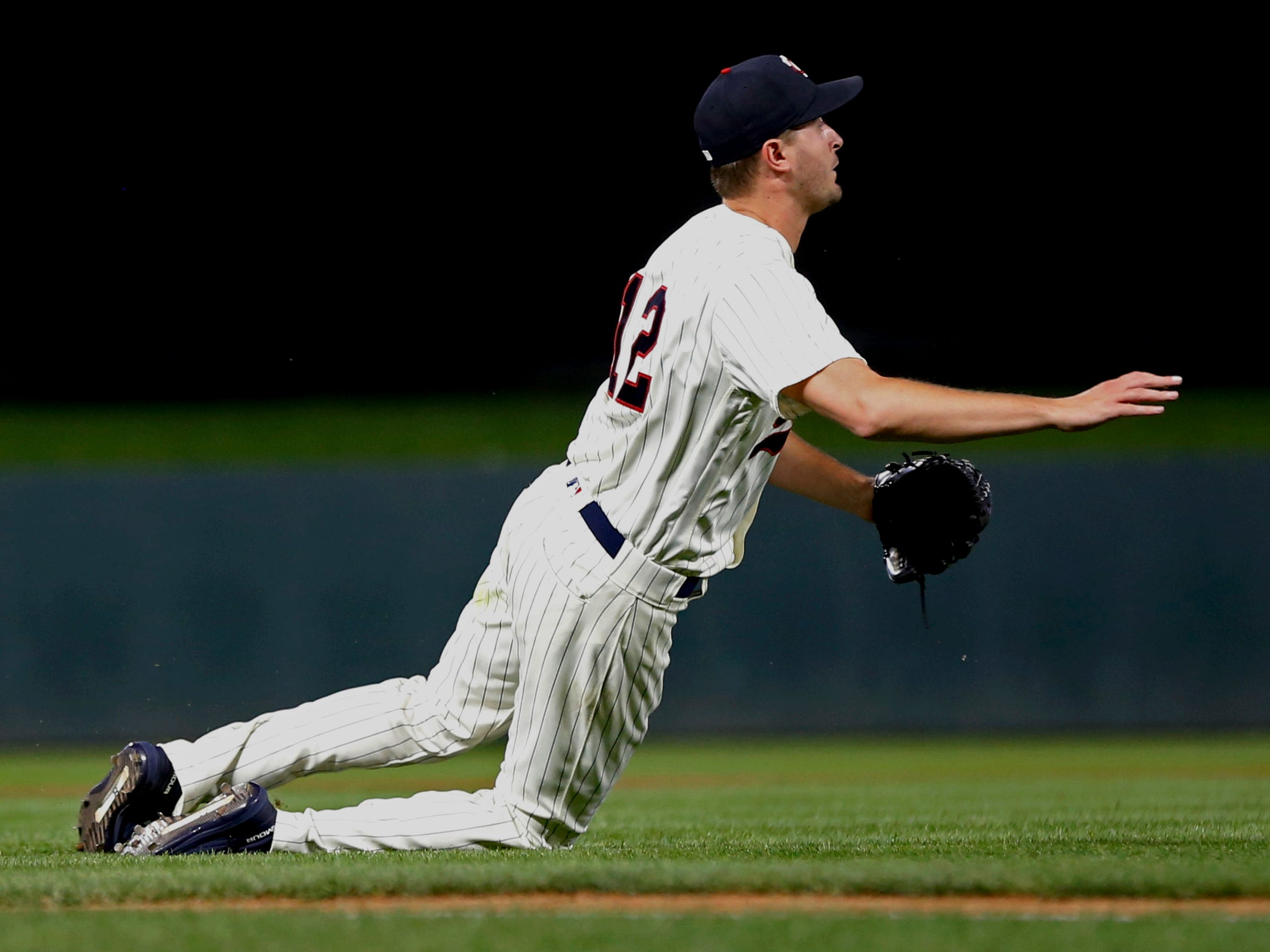 Minnesota Twins pitcher Jake Odorizzi watches as he throws out New York Yankees' Didi Gregorius who grounded to him in the fifth inning of a baseball game Wednesday, Sept. 12, 2018, in Minneapolis.