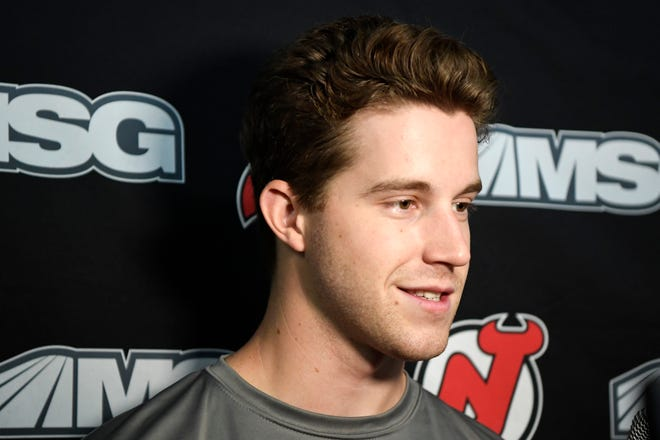 New Jersey Devils' Damon Severson talks to reporters during media day at the Prudential Center in Newark, NJ on Thursday, September 13, 2018.