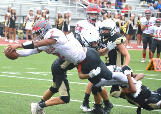 Fair Lawn running back Michael Lantigua diving over the goal line for a 5-yard touchdown against Bergen Tech.