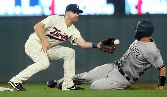 New York Yankees' Gary Sanchez beats the tag by Minnesota Twins second baseman Logan Forsythe to steal second base in the fifth inning of a baseball game Wednesday, Sept. 12, 2018, in Minneapolis.