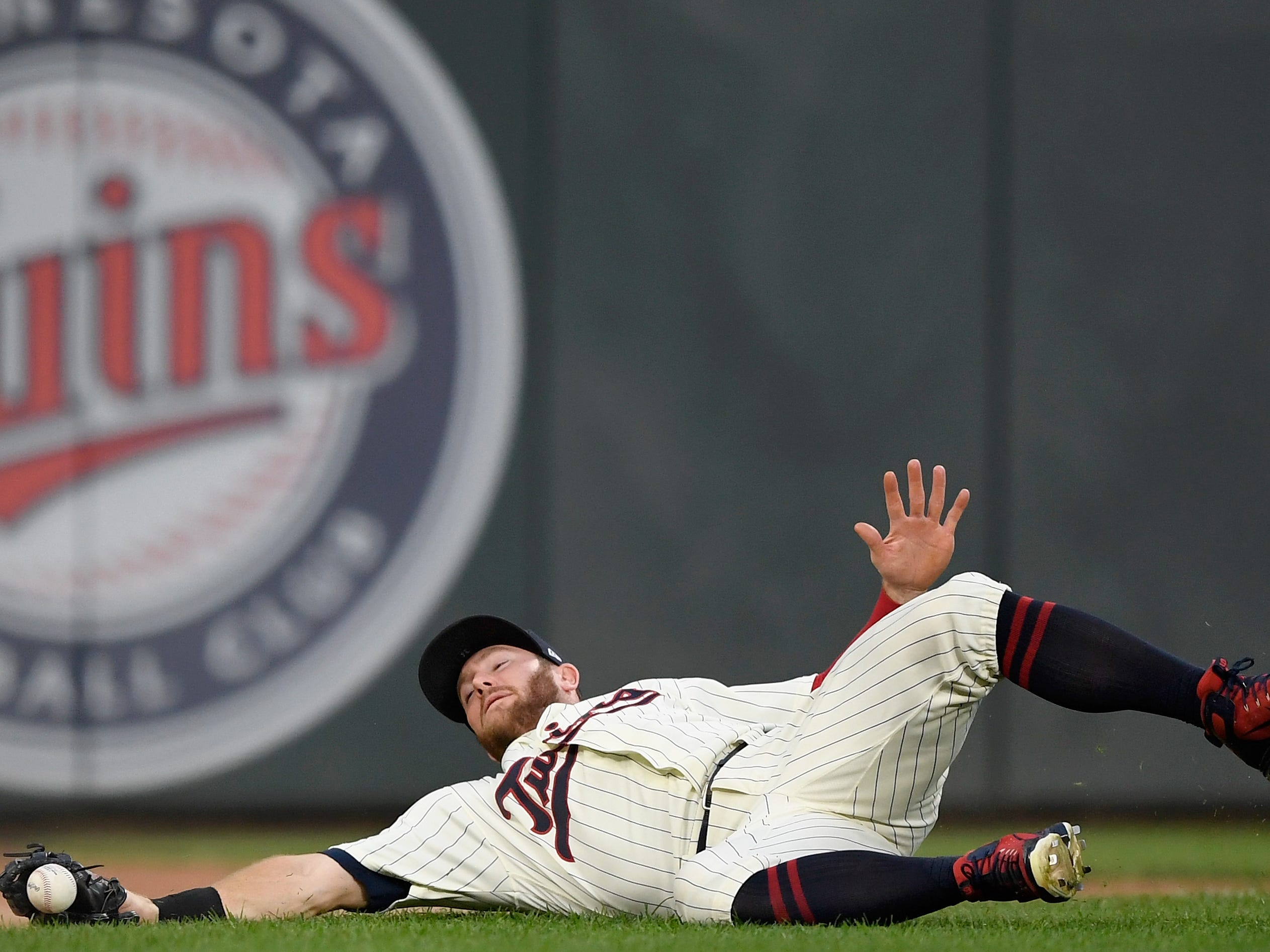 MINNEAPOLIS, MN - SEPTEMBER 12: Robbie Grossman #36 of the Minnesota Twins is unable to field a foul ball hit by Aaron Hicks #31 of the New York Yankees during the first inning of the game on September 12, 2018 at Target Field in Minneapolis, Minnesota.