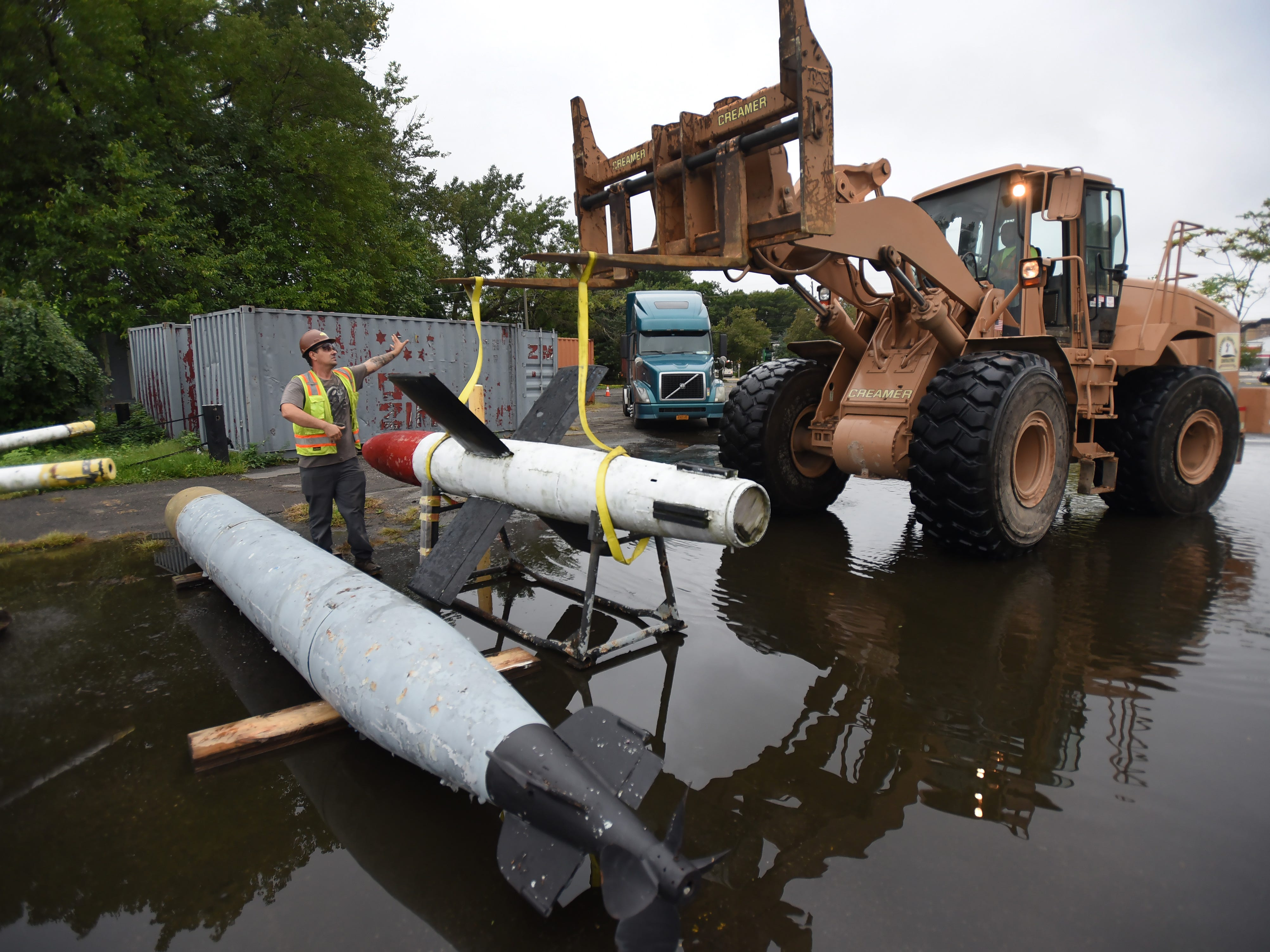 Two torpedoes are placed for loading later into the truck after being removed from the original site at the NJ Naval Museum in Hackensack on 09/12/18.  The 1945 USS Ling SS297, 312 foot long submarine remains at the site.