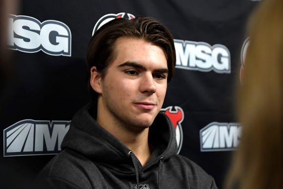 New Jersey Devils player Nico Hischier talks to reporters during media day at the Prudential Center in Newark, NJ on Thursday, September 13, 2018.