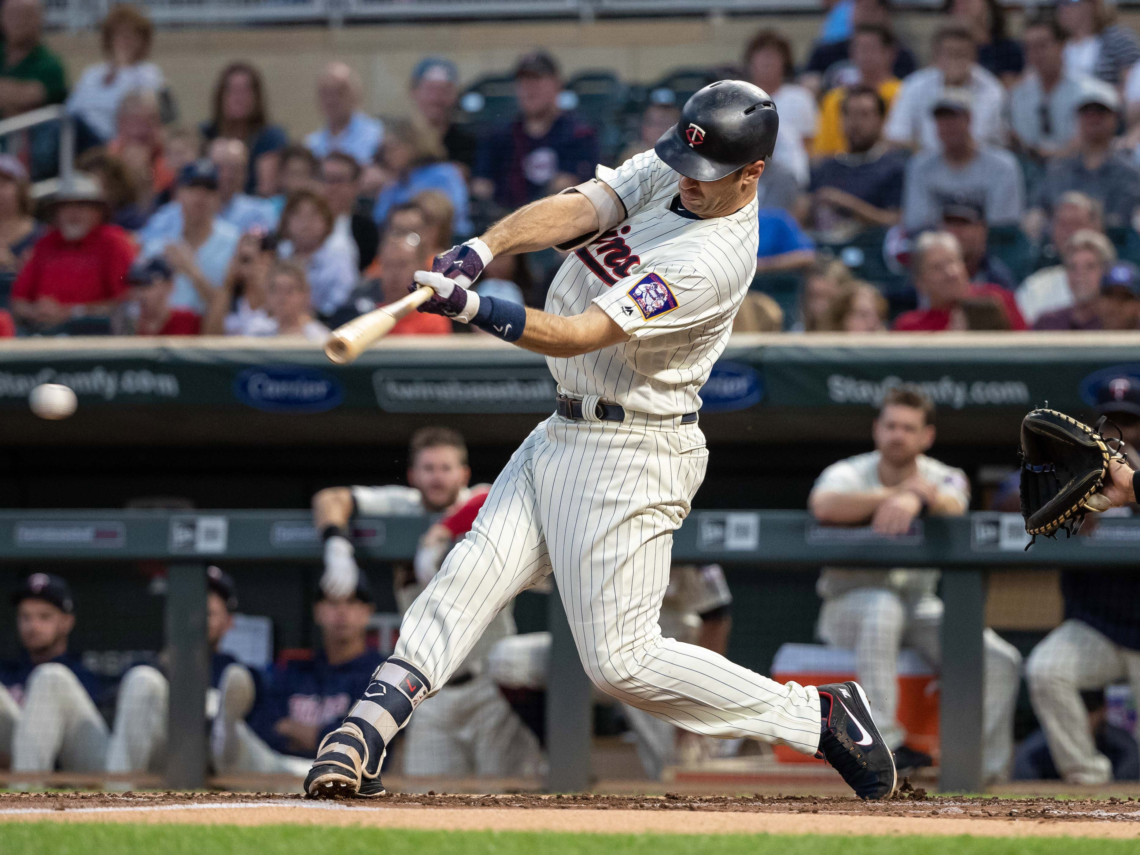 Sep 12, 2018; Minneapolis, MN, USA; Minnesota Twins first baseman Joe Mauer (7) hits a single during the first inning against the New York Yankees at Target Field.
