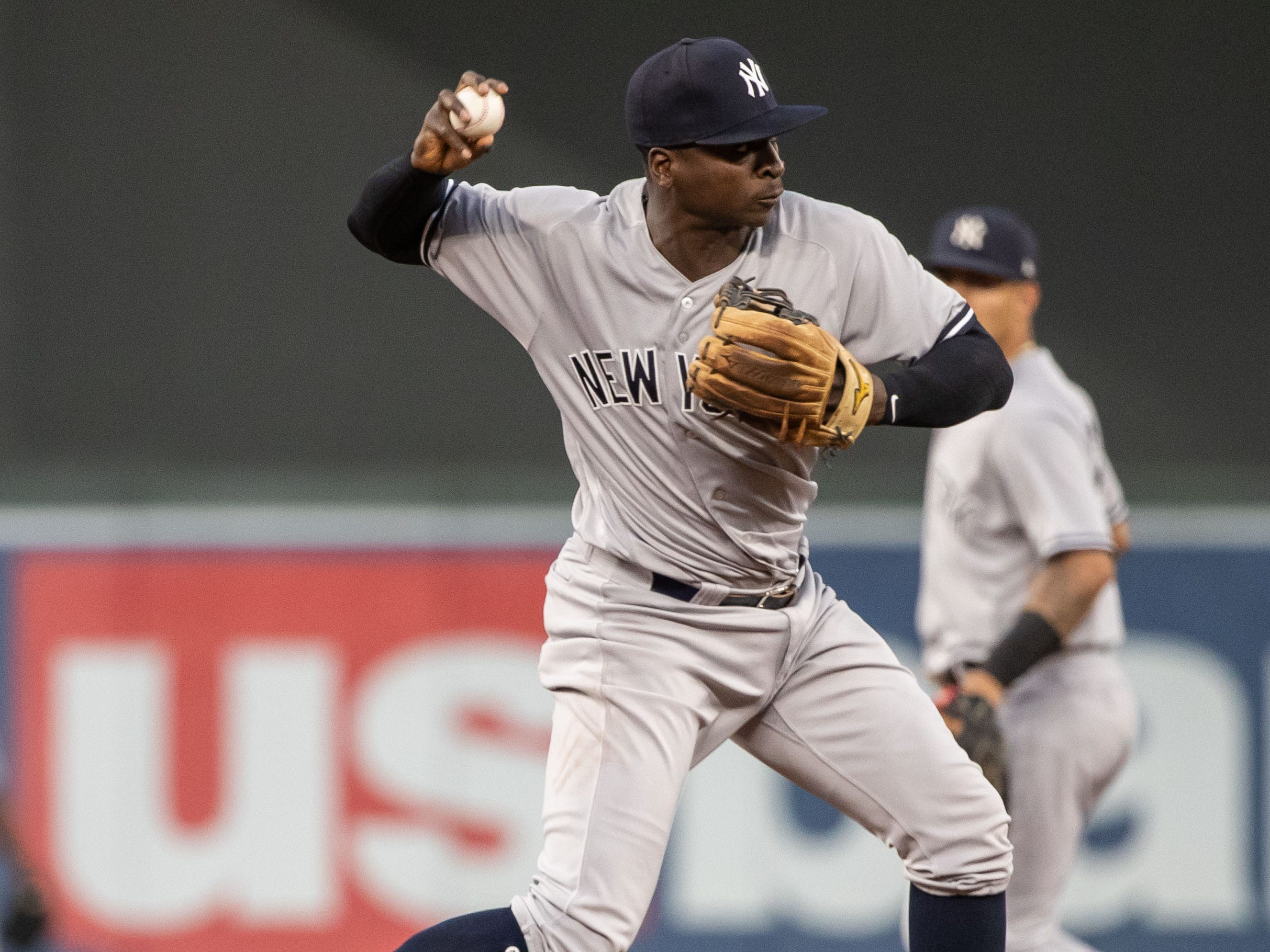 Sep 12, 2018; Minneapolis, MN, USA; New York Yankees shortstop Didi Gregorius (18) turns the double play for the out during the first inning against the Minnesota Twins at Target Field.
