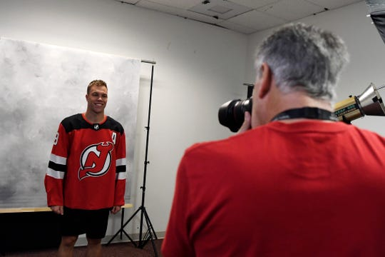 New Jersey Devils team photographer Andy Marlin, right, photographs left wing and league MVP Taylor Hall during media day at the Prudential Center in Newark, NJ on Thursday, September 13, 2018.