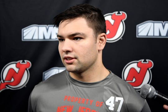 New Jersey Devils player John Quenneville talks to reporters during media day at the Prudential Center in Newark, NJ on Thursday, September 13, 2018.