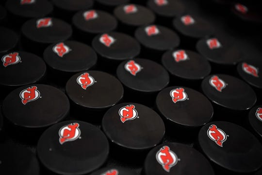 Pucks are lined up for autographs during the New Jersey Devils media day at the Prudential Center in Newark, NJ on Thursday, September 13, 2018.