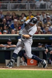 Sep 12, 2018; Minneapolis, MN, USA; New York Yankees first baseman Greg Bird (33) hits a RBI double during the eighth inning against the Minnesota Twins at Target Field.