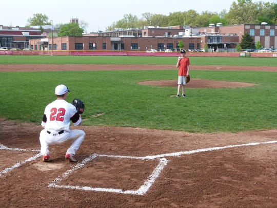 Quinn (right) threw out the first pitch to brother Ashton Dalessio during a Glen Rock baseball game in 2017.