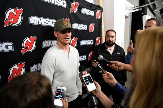 New Jersey Devils goalie Cory Schneider talks to reporters during media day at the Prudential Center in Newark, NJ on Thursday, September 13, 2018.