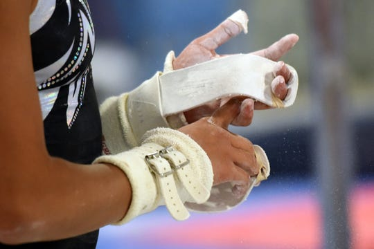 Corinne Bunagan 15, of Ramsey, a member of the Philippines National Gymnastics Team, is competing in the 48th Annual Artistic World Gymnastic Championships in Doha, Qatar beginning on October 25, 2018. Bunagan chalks her hands prior to working out on the bar while training at ENA Gymnastics in Paramus on Thursday, September 13, 2018.