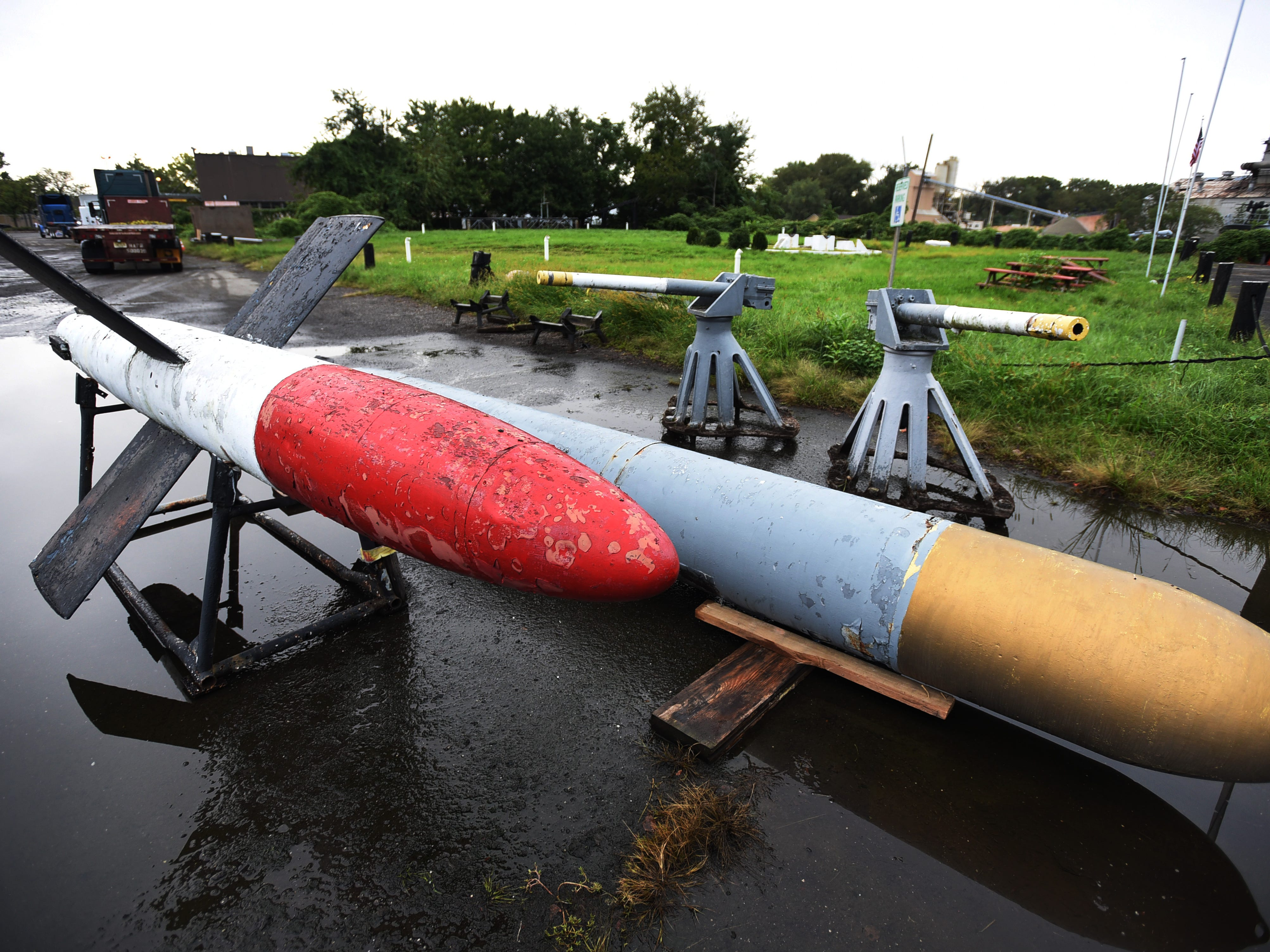 Two torpedoes and two canons wait to be hoisted onto the truck after being removed from the original site at the NJ Naval Museum in Hackensack on 09/12/18.  The 1945 USS Ling SS297, 312 foot long submarine remains at the site.