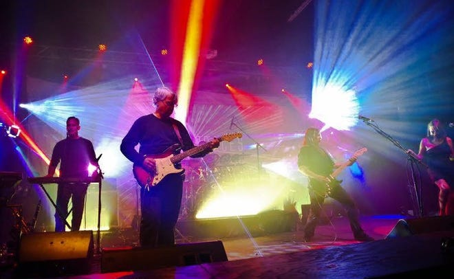 Members of Empty Spaces perform songs by Pink Floyd on stage.