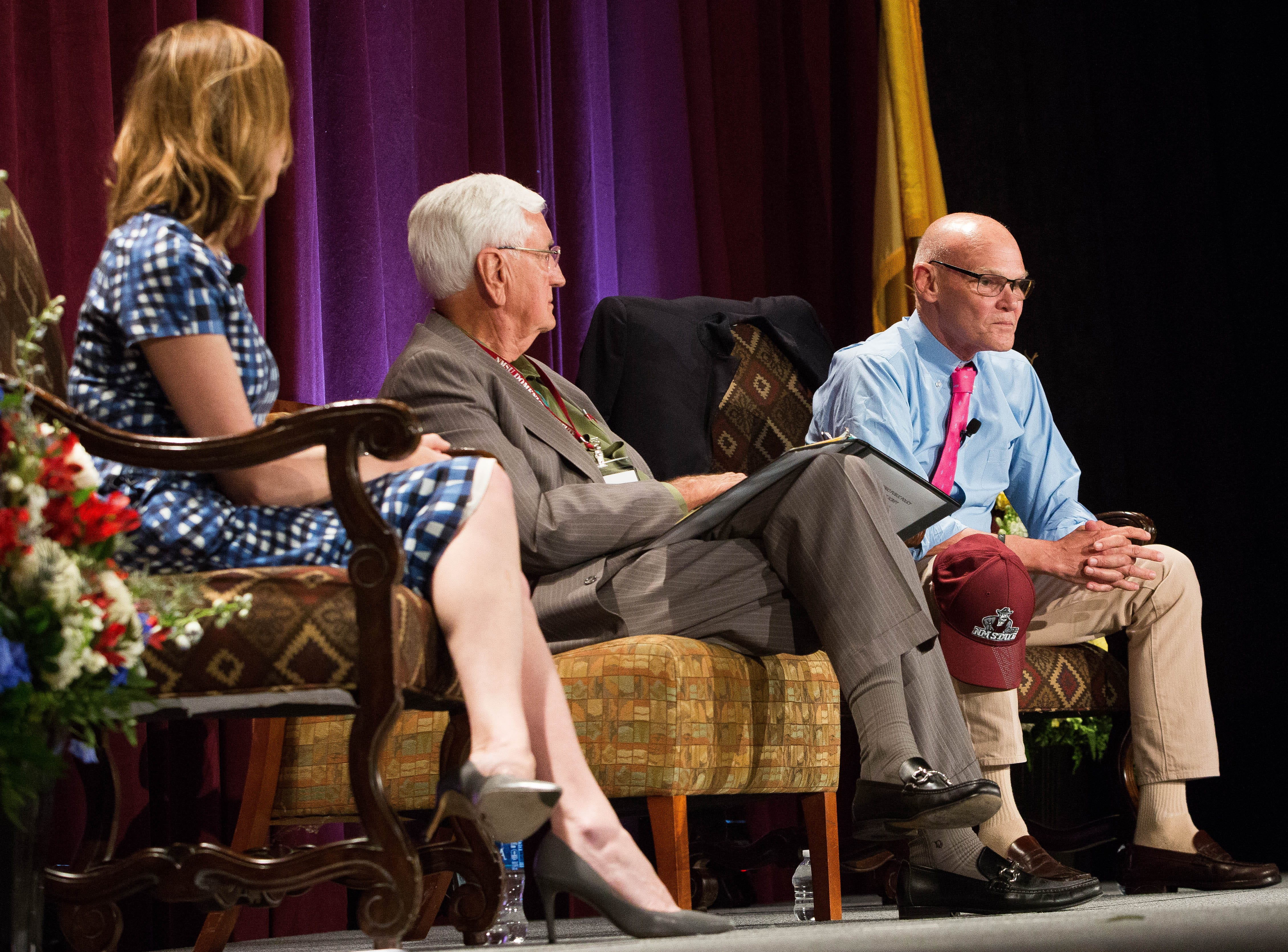 James Carville, right, political consultant, discuss the 2018 Mid Term elections and the Trump Presidency with Garry Curruthers, center, former New Mexico State University Chancellor and President and Kristen Soltis Anderson, left, co-founder and partner at Echelon Insights, during a panel discussion at the 2018 Domenici Public Policy Conference at the Las Cruces Convention Center, Thursday September 13, 2018.