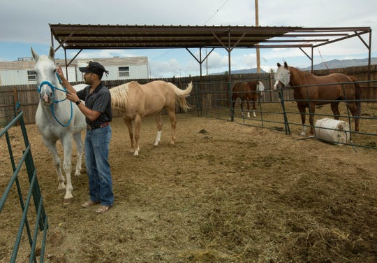 Kwamé Ponschock with his horse Keystone, whom he rides when he works as Pistol Pete at New Mexico State University football games.