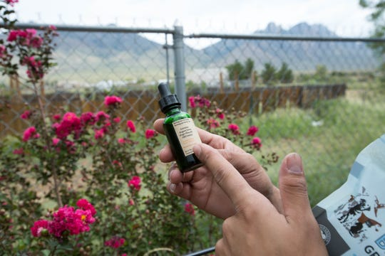 Kwamé Ponschock explains how he uses CBD tinctures for his pets and horses at his home on the East Mesa.