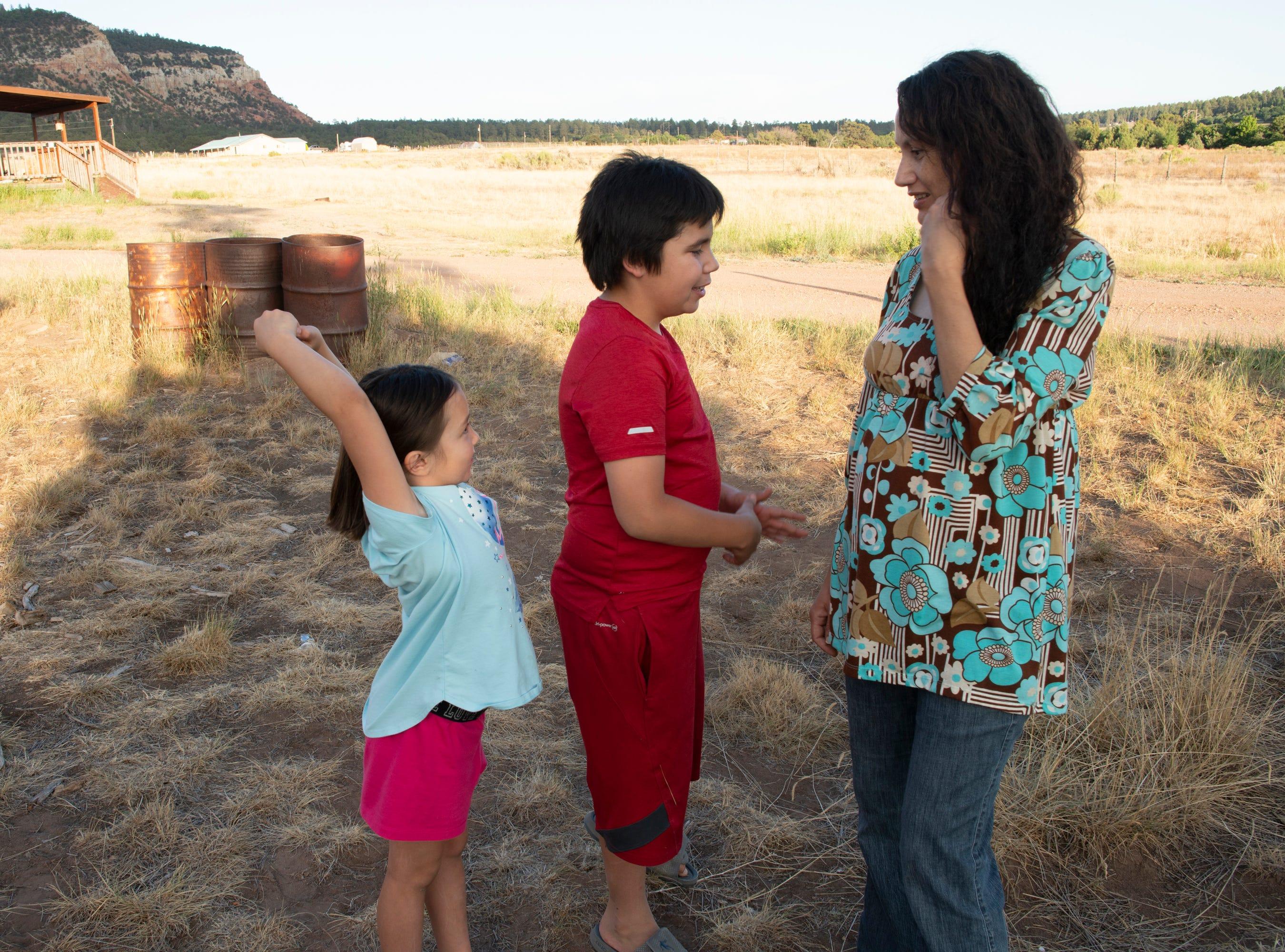 Emilia with her children in Gallina.