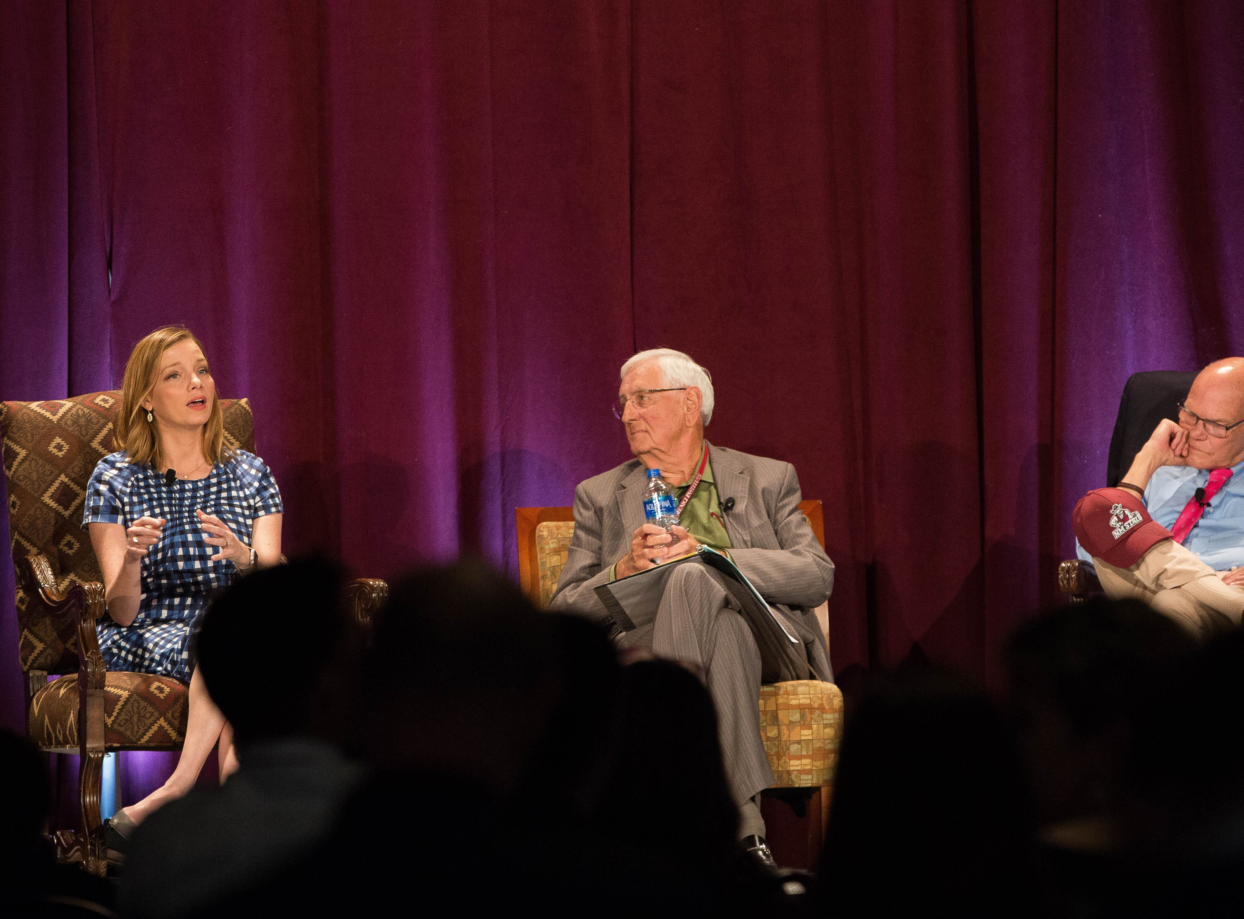 Kristen Soltis Anderson,left, co-founder and partner at Echelon Insights, opened up a panel discussion with Garry Curruthers, center, former New Mexico State University Chancellor and President moderating and James Carville, right, political consultant, discuss the 2018 mid-term elections, during the 2018 Domenici Public Policy Conference at the Las Cruces Convention Center, Thursday September 13, 2018.
