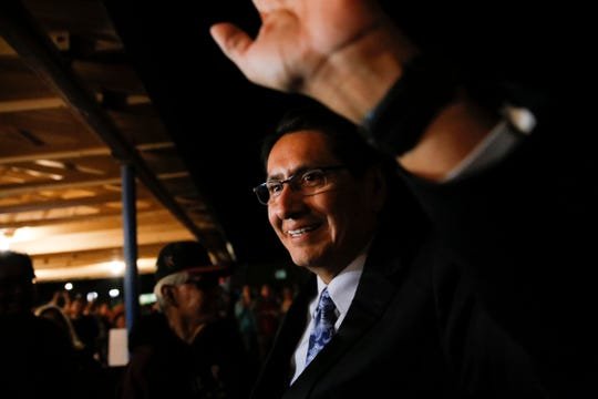 Navajo Nation Vice President Jonathan Nez waves to his supporters Aug. 28 at the Window Rock Civic Center in Window Rock, Ariz., after finishing first in the primary election for the tribal presidency.