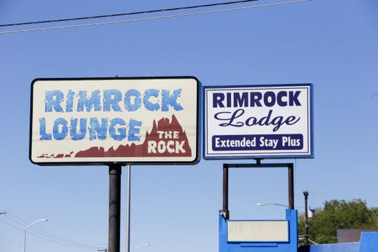 Signs for the Rimrock Lodge Extended Stay Plus are seen Thursday at 2530 Bloomfield Highway in Farmington.