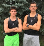 Plymouth's one-two punch this boys cross country season has been junior Carter Solomon (right) and sophomore Patrick Byrnes (left).