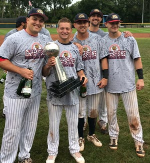 In his first year of minor league baseball, Bloomfield Hills native Todd Weiss (second from left) holds the USPBL championship trophy.