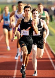 Northville's Nick Couyoumjian earned All-State honors last year in Division 1 track and cross country.