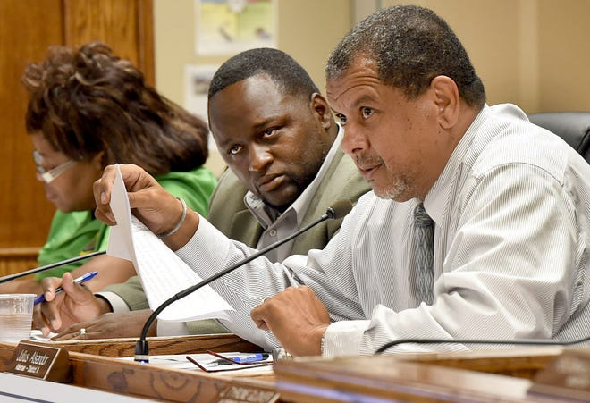 Councilman Julius Alsandor, right,  discusses the city budget during Tuesday's city council meeting alongside  Alderman Marvin Richard.