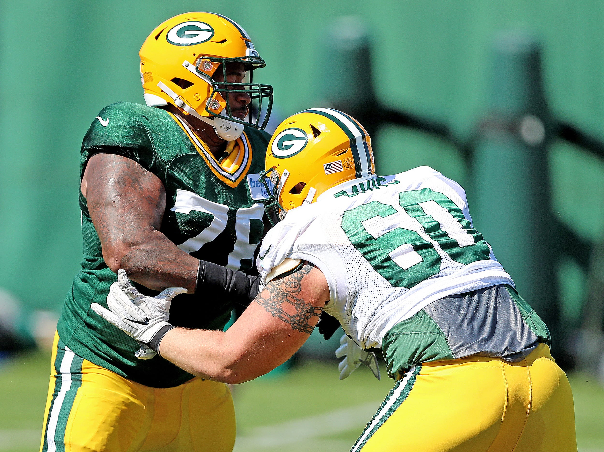 Green Bay Packers defensive tackle Mike Daniels (76) rushes against center Austin Davis (60) during practice September 13, 2018 at Clarke Hinkle Field in Ashwaubenon, WIs.