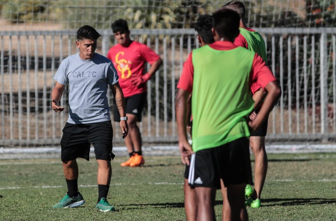Enrique Cardenas, left, coaches the College of the Desert soccer players during practice on Wednesday, September 12, 2018 in Palm Desert.