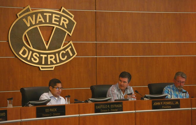 Coachella Valley Water District board members talk during a meeting in 2016.