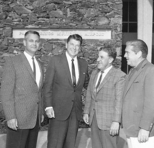 Unidentified man, California Gov. Ronald Reagan, Palm Springs Mayor Ed McCoubrey and Phil Regan c. 1967 at Palm Springs Municipal Airport.