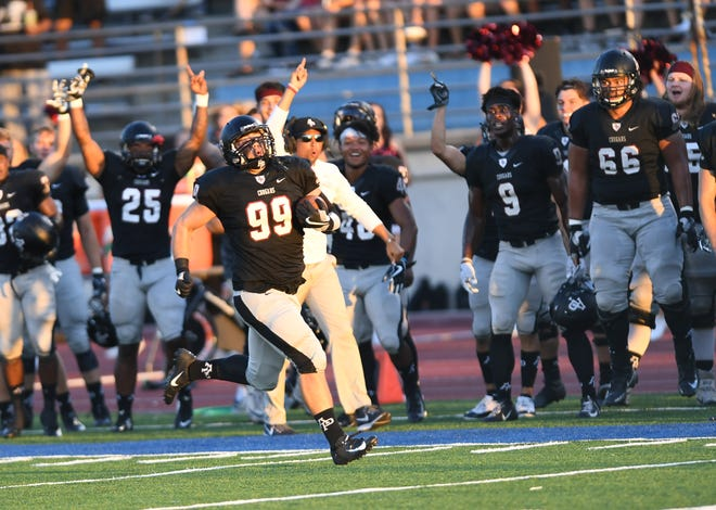 The sideline roars as Robbie Polimeni, a La Quinta grad, rumbles toward the end zone after an interception Saturday.