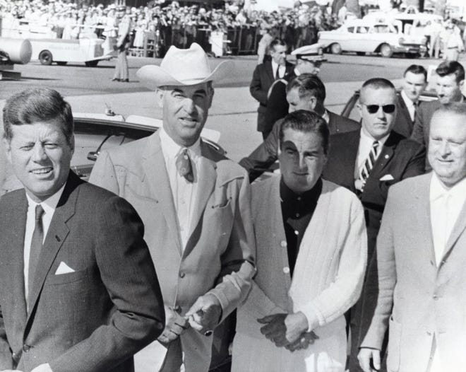 """President John F. Kennedy arriving at the Palm Springs Municipal Airport greeted by Palm Springs' Mayor Frank Bogert, Phil Regan and Palm Springs Chief of Police August """"Gus"""" Kettmann.  c. 1962"""