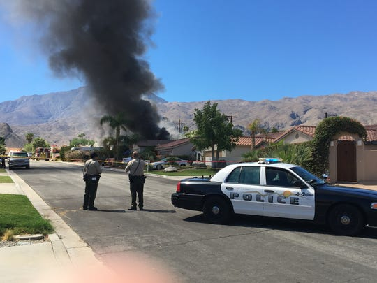A home is seen on fire in La Quinta during an investigation into a homicide.